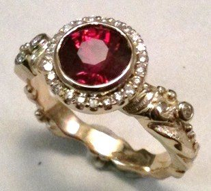 Ruby set in a diamond halo